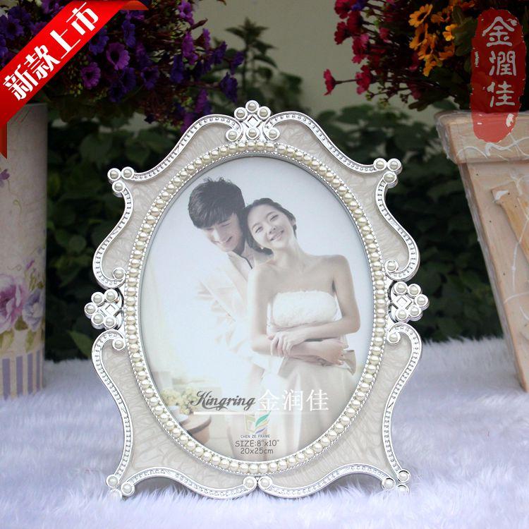 2014新款婚纱照欧式椭圆形相框摆台树脂相架创意礼品影楼批发图片