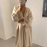 查看精选MONA 慵懒风针织开衫中长款毛衣女加厚燕麦色过膝收腰外套秋冬季最新价格