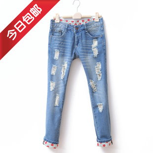 2012 spring clothing new Korean women washed white hole hemming jeans pencil pants feet pants WK1027