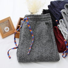 The new winter sports leisure plus sweat pants Elastic waist pants draw string and feet Easy to grasp sweat pants Don't drop cloth with soft nap