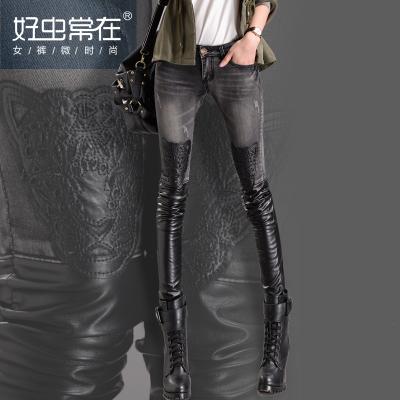 2014 new women's autumn and winter PU leather stitching jeans female feet long pants thin Slim pencil pants