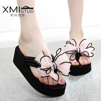 夏季韩版潮坡跟蝴蝶结人字拖女防滑厚底高跟沙滩鞋夹脚时尚凉拖鞋