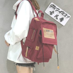 帆布双肩包男背包电脑包学院风大学生书包女大容量旅行包